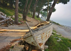 Old boat next to a road on Cavtat costline, Croatia