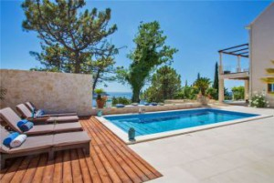 View of swimming pool with sea view from luxury holiday villa near Durbrovnik, Croatia