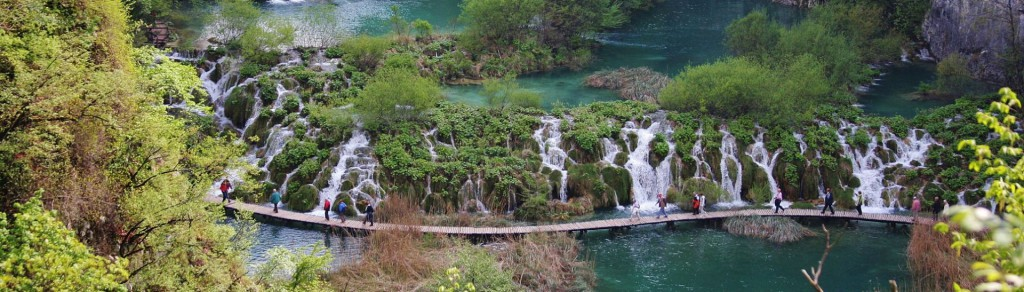 Water path in Plitvice park, Croatia with beautiful waterfall behind it