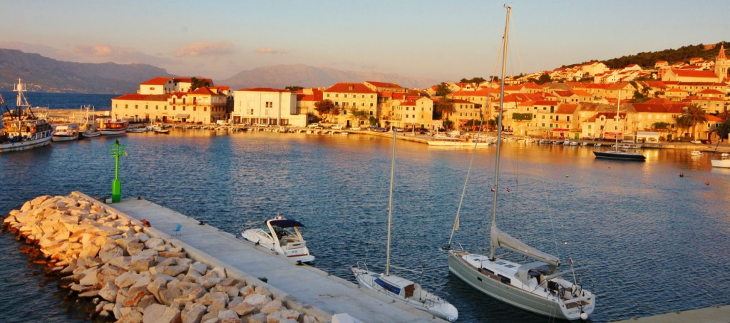 Sunset over Postira's harbour on Brac Island, Croatia