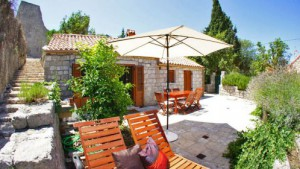 Terrace view of a stone cottage for 2-3 people on Peljesac